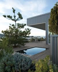 photo 1 of 16 in 16 boxy modern pools for this summer from amazing the reflecting pool is surrounded by foliage and breathtaking views of the bay tagged