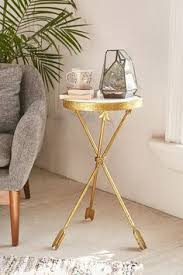 nursery accent table distressed gold arrows create the tripod base of our side table a