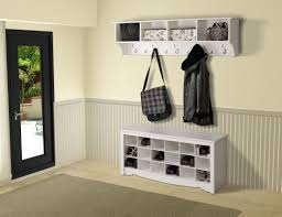 dark wooden entry storage bench with coat rack and tall mirror of