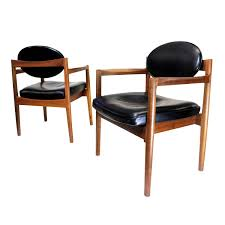 pair of mid century modern black leather oval back armchairs by