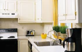 how to clean factory painted kitchen cabinets how to paint your kitchen cabinets kitchen cabinets