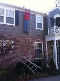 people who hang christmas lights viral people stop for dummy hanging from roof fox2now com