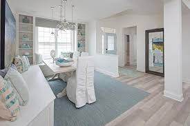 blue and white cottage dining room with window seat dining bench