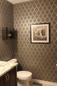 love the idea of doing a stencil pattern in a small bathroom to
