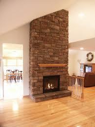 contemporary circular fireplace design with hanging glass mantel