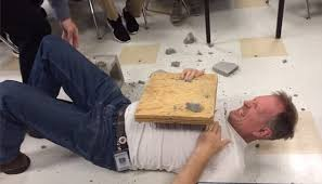 physics teacher avoids the chop after swinging axe into co