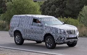nissan navara 2020 nissan is readying a tough body on frame suv as our spies nabbed