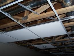 tile installing ceiling tiles in basement home design image