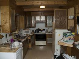 Kitchen Work Triangle by Rustic Kitchen Cabinetry On White Wall Paint Ceramic Flooring Tile