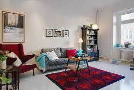 living room colorful pillows bookshelf wall frame decor