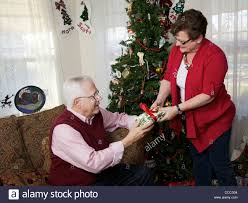 present for 60 year woman 50 60 year woman giving christmas present to husband stock