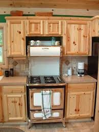 awesome brown color knotty pine kitchen cabinets come with cream