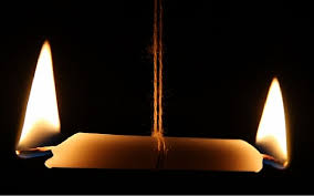 light a candle for someone what does the phrase looks like someone been burning the candle at