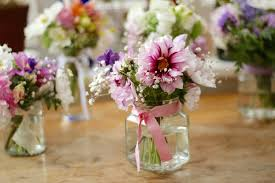 wedding flowers jam jars simple flowers in jam jars for table centrepieces