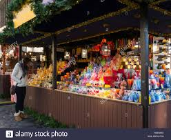 market stall selling christmas candles christmas decorations stock