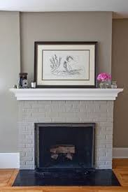 How To Decorate A Brick Fireplace How I Updated Our Fireplace By Painting The Outdated Brass Cover