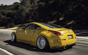 nissan 350z yellow color nissan 350z stance nissan yellow road speed in motion hd wallpaper