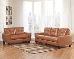 Benchcraft Leather Sofa by Buy Paulie Durablend Orange Living Room Set By Benchcraft From