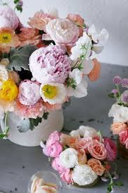centerpieces pretty garden party flowers bottles with lace