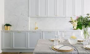 White Kitchen Cabinets With Brass Hardware And Marble Backsplash - Marble backsplash kitchen