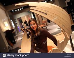 at home interiors a woman smiles in easy chair u0027barca u0027 at home interiors trade show