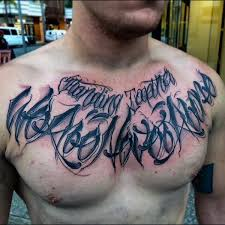 bloody black lettering tattoo male chest inspiration templo