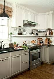 Black Or White Kitchen Cabinets White Top Cabinets Black Bottom Cabinets Design Ideas