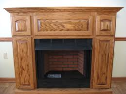 mid continent style wooden fireplace mantel with metal framed