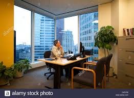 business woman executive in a corner office sitting at the desk