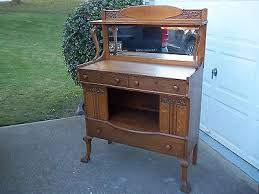 antique tiger oak sideboard buffet with beveled mirror