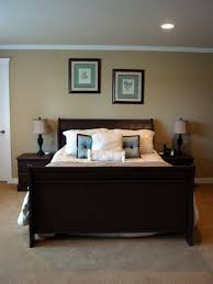 comfortable small bedrooms design with classic dark wood bed