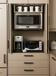 kitchen pantry cabinet with microwave shelf pocket doors in kitchen cabinetry perfect for hiding a tv