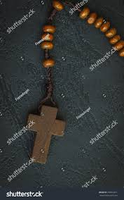 christian cross necklace on holy bible stock photo 256814311
