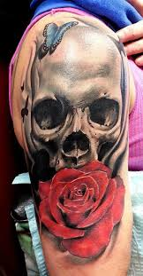 beautiful red rose with butterfly and skull tattoo on half sleeve