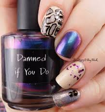 mixed animal print holographic manicure with crowstoes nail color
