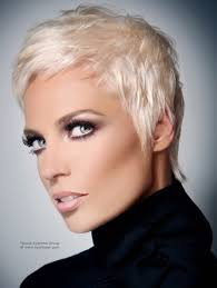 very short blonde hairstyle annie lenox or pink look