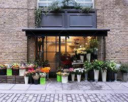 flower shop flower shop exterior in with brickwall facade stock photo