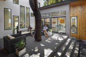 bold and modern u shaped courtyard house designed around trees