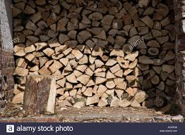 wood for wood burning stacked blocks of cut wood for wood burning stove in store uk