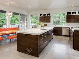 kitchen with island sink cabinets and dining table in new luxury kitchen with island sink cabinets and dining table in new luxury home stock photo