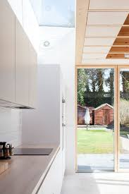 floor to ceiling glass doors a charred wood and glass extension was designed for this dublin