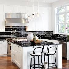 black subway tile kitchen backsplash white kitchen cabinets with black brick tile backsplash