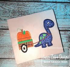 dinosaur pulling cart with pumpkin appliqué embroidery design