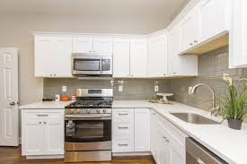 modern kitchen oven kitchen style white flat paneled cabinet and stainless steel gas