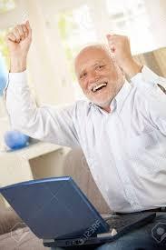 Man On Computer Meme - old man celebrating at home laughing and raising arms having