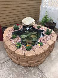 above ground pond using garden wall blocks patio pond fish