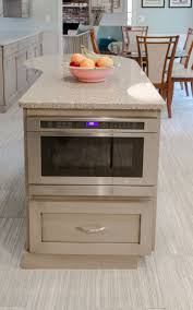 kitchen island built in microwave extra storage and prep space