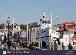 harbor tour and deep sea fishing boats at dock in hyannis harbor