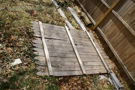 a privacy fence room divider covering up an outdoor eye sore