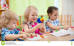 kids making arts and crafts children in kindergarten stock photo